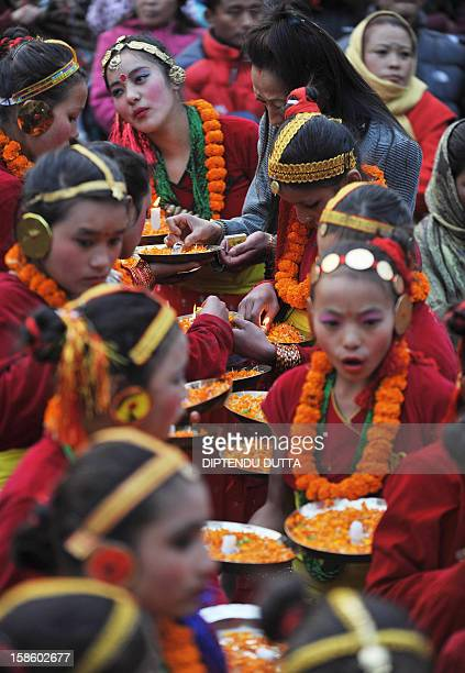 Indian girls of Nepali origin prepare before performing during the inauguration of the Darjeeling Tea and Tourism Festival in the northern hill town...