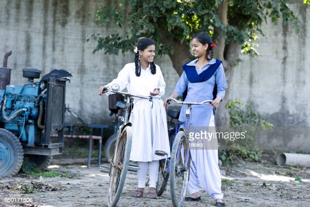 Indian girls with bicycle