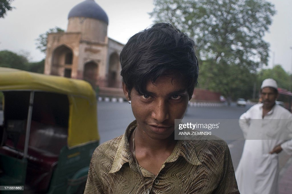 Indian glue-sniffer Salim poses for a photograph at the roadside in New Delhi on June 26, 2013, on the International Day Against Drug Abuse and Illicit Trafficking. Activists in the city launched the 'Support Don't Punish' campaign calling for the removal of legal sanctions on low-level drug offenses and encouraging 'harm reduction' services such as needle exchange and opoid substitution therapy. AFP PHOTO/ Anna ZIEMINSKI