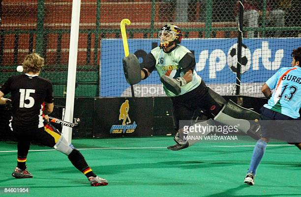 Indian goalkeeper Baljit Singh dives to stop a shot at goal against Germany during the fournation Punjab Gold Cup in Chandigarh on February 3 2009 as...