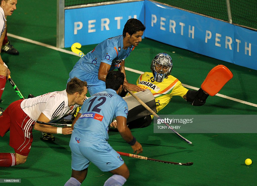 Indian goalkeeper Sreejesh Parattu Raveendran (R) tries to save a goal attempt by Simon Egerton (L) of England during their men's match at the International Super Series hockey tournament in Perth on November 22, 2012. AFP PHOTO/TONY ASHBY -- IMAGE STRICTLY FOR EDITORIAL USE - STRICTLY NO COMMERCIAL USE