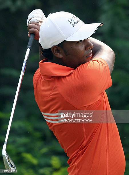 Indian golfer Ashok Kumar tees off on the thirteenth hole during the third round of the Hero Honda Indian Open at the Delhi Golf Club in New Delhi on...