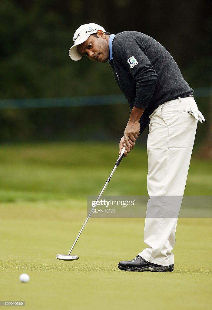 Indian golfer S.S.P Chowrasia putts on the 1st green on the first day of the PGA Championship on the West Course at Wentworth, central England on May 20, 2010.