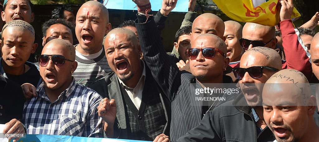 Indian Gorkha activists, with shaved heads as a sign of protest, shout slogans to voice their demands for a separate state within India for the Gorkha people during a demonstration in New Delhi on February 7, 2013. Gorkhas want a separate state in the Darjeeling area of the state of West Bengal to be named Gorkhaland.