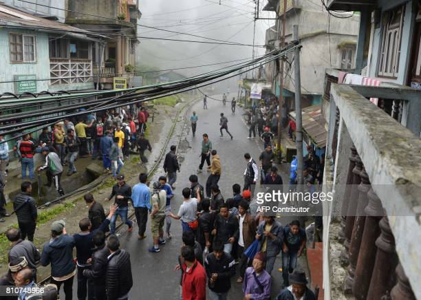 Indian Gorkhaland supporters gather along a street following clashes with the police during an indefinite strike called by Gorkha Janamukti Morcha in...