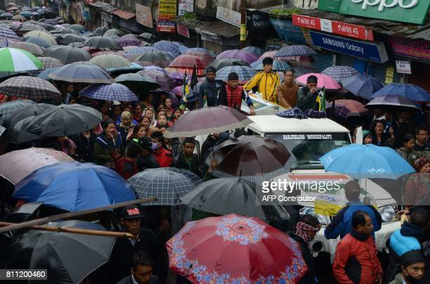 Indian Gorkhaland supporters march during a rally in memory of activists killed on July 8 during clashes with police according to the Gorkha Janmukti...