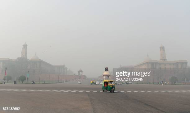 Indian government department buildings are covered by heavy smog in New Delh on November 13 2017 Schools reopened in New Delhi on November 13 despite...