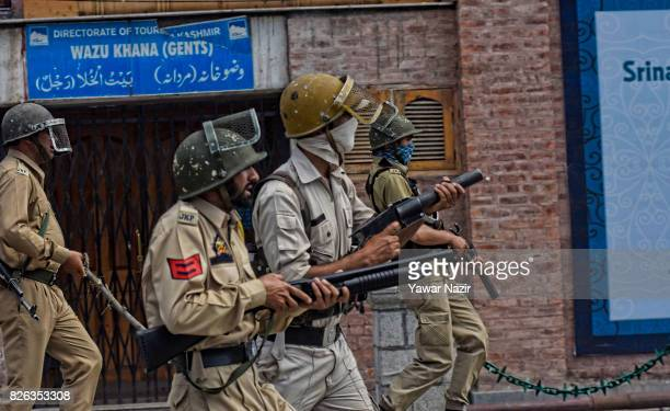 Indian government forces aim their guns at Kashmiri Muslim protester outside Kashmir's grand mosque during an antiIndia protest on August 04 2017 in...