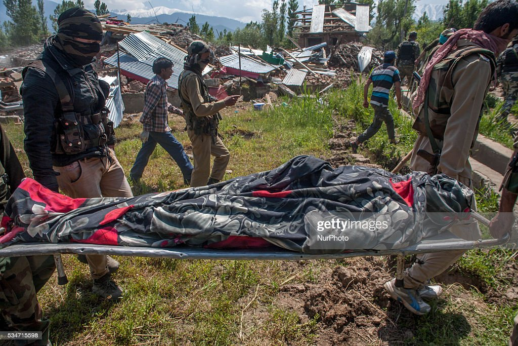 Indian government forces carry the body of a local rebel killed in a gunfight after a gun battle between militants and Indian government forces on May 27, 2016 in Khonchpur, 40 kilometers (25 miles) west of Srinagar, the summer capital of Indian administered Kashmir, India. Six rebels and an Indian army soldier were killed in two separate gun battles in the north Kashmir today.