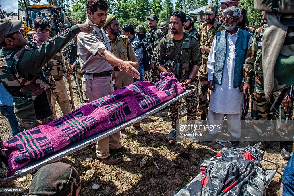 Indian government forces carry the body of local rebels killed in a gun battle between militants and Indian government forces on May 27, 2016 in Khonchpur, 40 kilometers (25 miles) west of Srinagar, the summer capital of Indian administered Kashmir, India. Six rebels and an Indian army soldier were killed in two separate gun battles in the north Kashmir just four days after the Indian police claimed to have gunned down two unidentified militants in Sarai Bala area of Srinagar, a claim contested by the locals who say they were just students putting up in the locality.