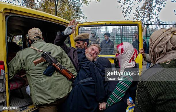 Indian government forces detain a Kashmiri man near the venue of a protest rally called by proresistance leaders during the visit of Indian Prime...