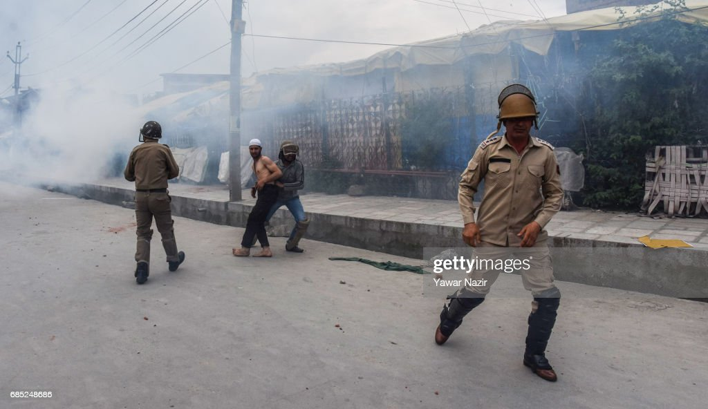 Indian government forces detain a Kashmiri Muslim protester who was throwing stones at them during an anti India protest on May 19, 2017 in Srinagar, the summer capital of Indian administered Kashmir, India. Indian government forces used teargas shells to disperse dozens of Kashmiri Muslim protesters who were throwing stones at them during an anti Indian protest in the Old City of Srinagar, after Friday prayers.