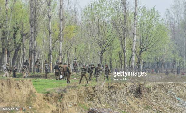 Indian government forces fire at Kashmiri Muslims civilians as they tried to march towards gun battle site during a gun battle between Indian...