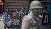 Indian government forces guard a deserted road following violence that has left over 46 people dead and thousands injured on July 23 2016 in Srinagar...