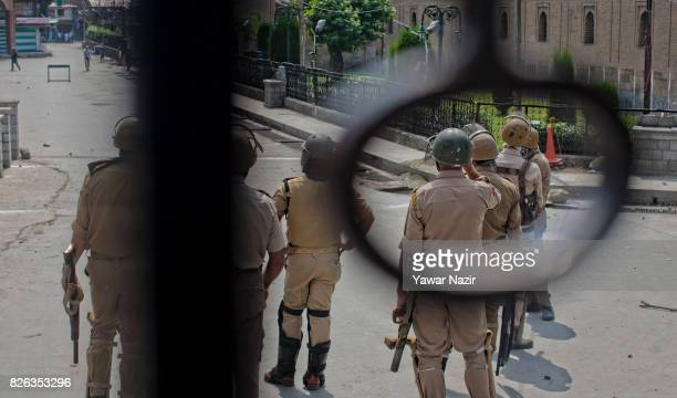 Indian government forces look towards Kashmiri Muslim protesters outside Kashmir's grand mosque during an antiIndia protest on August 04 2017 in...