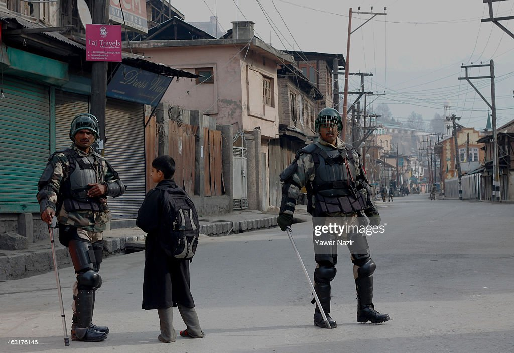 Indian government forces patrol a street amid restrictions and an undeclared curfew on the death anniversary of Maqbool Bhat on February 11 2015 in...