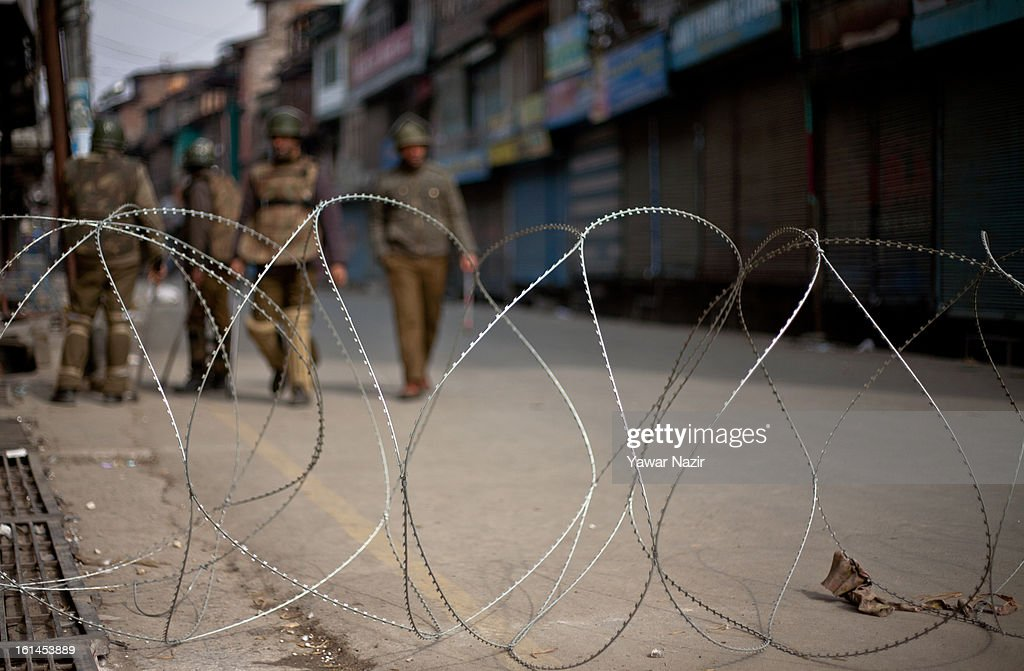 Indian government forces patrol deserted streets during a curfew on the third consecutive day after India hanged Indian parliament convict Afzal Guru on February 11, 2012 in Srinagar, the summer capital of Indian Administered Kashmir, India. Three youths have been killed during different protests in the Kashmir valley since Indian Parliament attack convict Mohammad Afzal Guru was sent to gallows in New Delhi's Tihar Jail. Guru's family is seeking the return of his remains as Guru was buried inside the fortified jail.