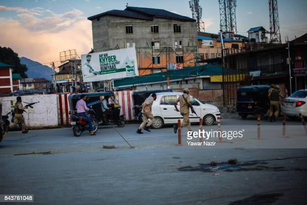 Indian government forces search for suspected militants near the site after a grenade attack by suspected militants in a busy market on September 7...