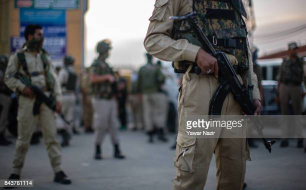 Indian government forces stand alert near the site after a grenade attack by suspected militants in a busy market on September 7 in Srinagar the...