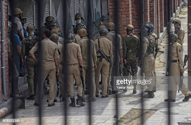 Indian government forces stand alert outside Kashmir's grand mosque during an antiIndia protest on August 04 2017 in Srinagar the summer capital of...