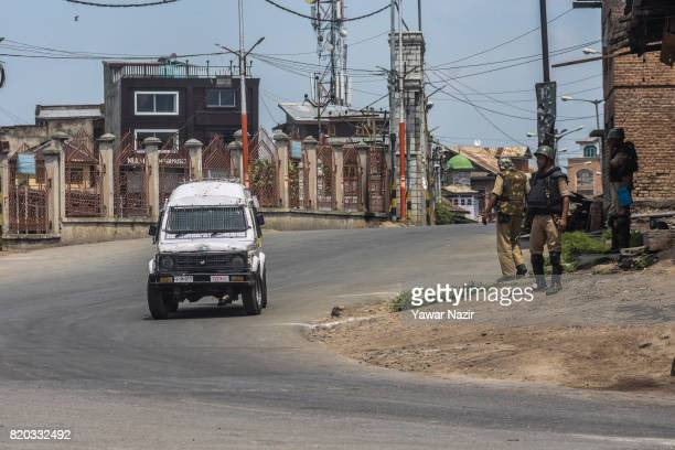 Indian government forces stand guard during curfew on July 21 2017 in Srinagar the summer capital of Indianadministered Kashmir India Thousands of...
