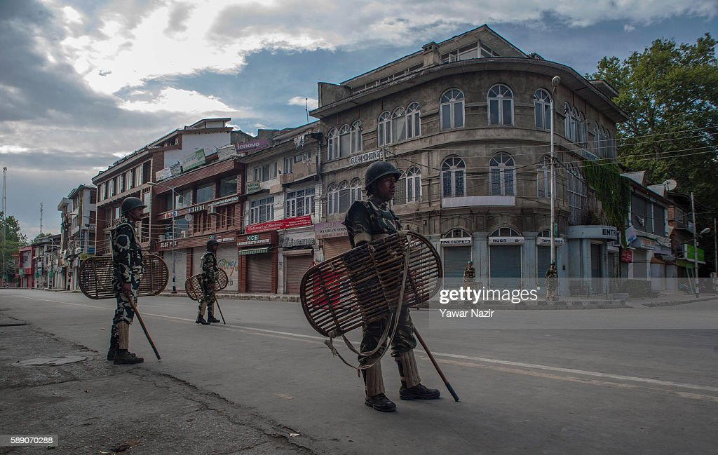 Indian government forces stand guard in the city center to thwart anit Indian Protest marches of Kashmiri Muslims during curfew on the 35th day...