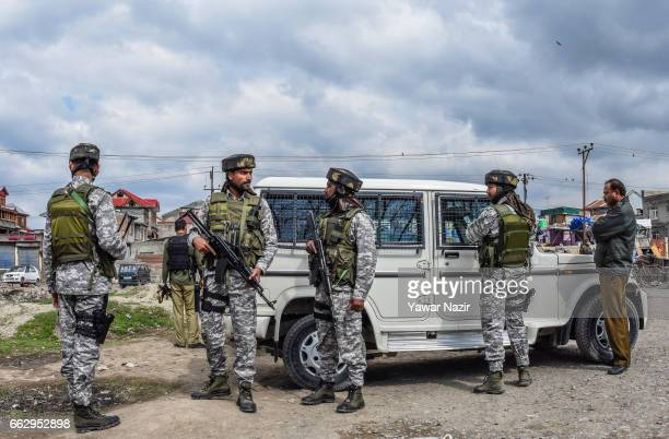 Indian government forces stand guard near the scene of attack by suspected militants on the convoy of Indian military forces on April 01 2017 in...