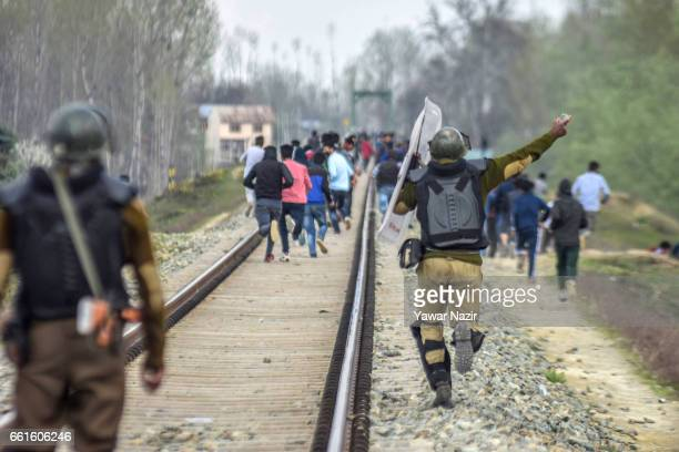 Indian government forces throw stones at Kashmiri Muslim protesters during an anti India protest against the recent civilian killings by Indian...