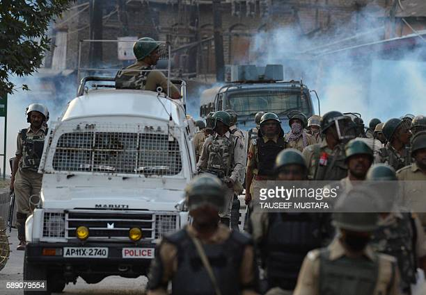 TOPSHOT Indian government forces walk back towards a camp after a day of curfew in downtown Srinagar on August 13 2016 kIndianadministered Kashmir...