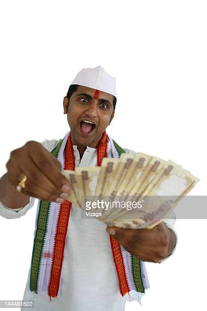 Indian greedy politician holding money