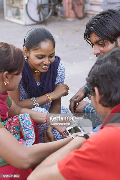 Indian group with mobile phone