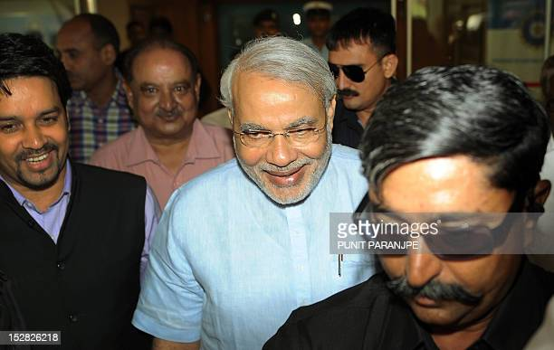 Indian Gujarat state Chief Minister Narendra Modi leaves after attending the Annual General Meeting at the Board of Control for Cricket in India head...