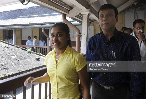 Indian Gymnast Dipa Karmakar with her coach Bisweshwar Nandi arrives for felicitation ceremony organised by Bengal Chamber of Commerce on September...