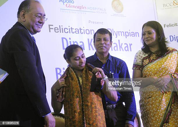 Indian Gymnast Dipa Karmakar with her coach Bisweshwar Nandi felicitated by Bengal Chamber of Commerce on September 19 2016 in Kolkata India...