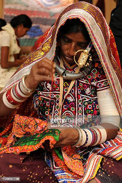 Indian handicraft artisan Sojaben stitches traditional embroidery during The Craftroots Festival in Ahmedabad on January 8 2010 The Craftroots...