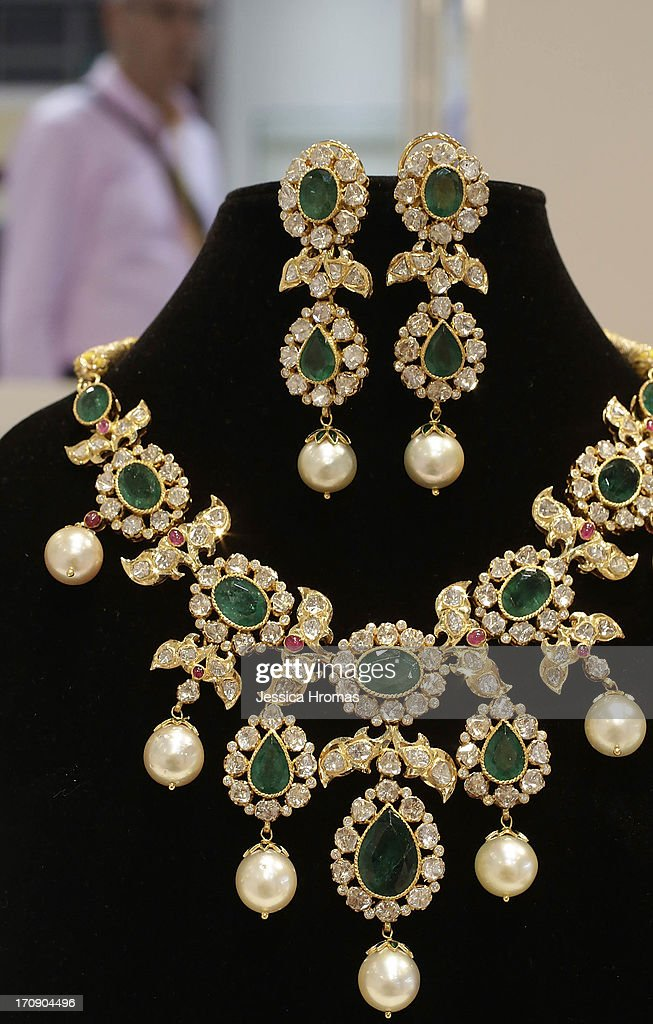 Indian handmade necklace and earrings, from 22 kart gold, with rose cut diamonds, emeralds and south sea pearls, by Panna Handicrafts, valued at USD $16,800, are displayed at the Hong Kong Jewellery and Gem Fair on June 20, 2013, in Hong Kong, Hong Kong. The June Hong Kong Jewellery & Gem Fair runs from June 20 - 23.