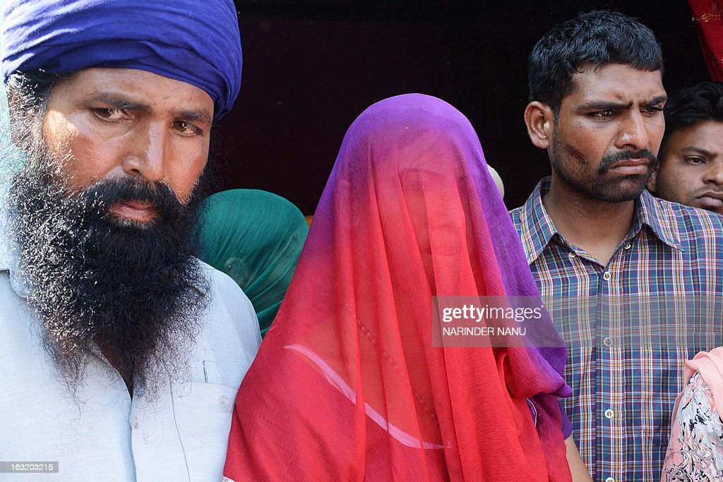 Indian Harbrinder Kaur (C),22 , who was allegedly beaten by police along with her father Kashmir Singh (L), and brother Gurjinder Singh (R) arrive to speak to the media at Usman village near Tarn Taran district about 25 kms (15 miles) from Amritsar on March 6, 2013. Taking serious view of the alleged beating of Kaur by policemen in Punjab's Tarn Taran district, Chief Minister Parkash Singh Badal today ordered a magisterial probe into the incident. The 22-year-old girl and her father were allegedly beaten by policemen when they sought to lodge a complaint against some persons who teased the girl and passed vulgar comments in public. AFP PHOTO/ NARINDER NANU