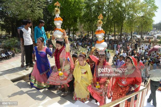 Indian hijras arrive at the Paanchdev Mandir during a religious procession in Gandhinaar some 30 km from Ahmedabad on March 22 2017 Hijra is a term...