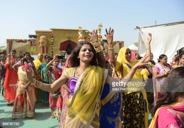 Indian hijras dance as they participate in a religious procession in Gandhinagar some 30 km from Ahmedabad on March 22 2017 Hijra is a term used in...