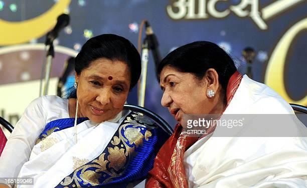 Indian Hindi and Marathi language Bollywood playback singer Lata Mangeshkar speaks with her sister Asha Bhosle also a playback singer during the...