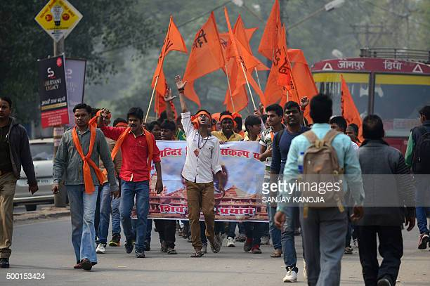 Indian Hindu activists from the Shiv Sena group march as they demand the construction of a Hindu temple in Ayodhya on the anniversary of the...