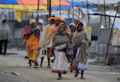 Indian Hindu devotees arrive at Sangam for the Magh Mela festival in Allahabad on January 18 2014 The Magh Mela is held every year on the banks of...