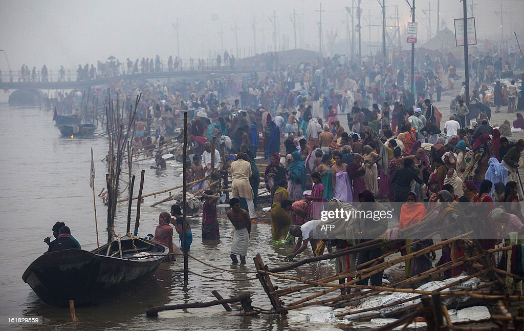 Indian Hindu devotees bathe at the Sangam or confluence of the Yamuna, Ganges and mythical Saraswati rivers during the Kumbh Mela in Allahabad on February 17, 2013. The Kumbh Mela in the town of Allahabad will see up to 100 million worshippers gather over 55 days to take a ritual bath in the holy waters, believed to cleanse sins and bestow blessings. AFP PHOTO/ Andrew Caballero-Reynolds