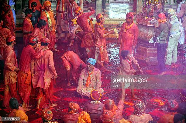 Indian Hindu devotees celebrate Lathmar Holi at the Radha Rani temple in Barsana on March 21 2013 Lathmar Holi is a local celebration but it takes...
