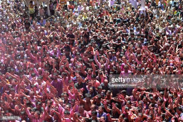 Indian Hindu devotees celebrate the Holi festival at the Swaminarayan Temple in Ahmedabad on March 13 2017 The Hindu festival of Holi or the...