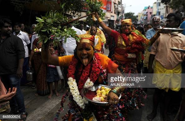 Indian Hindu devotees dressed as the goddess Kali dance in a trance as they perform a ritual during a procession to mark Shivratri in Chennai on...