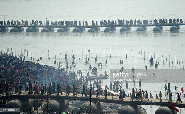 Indian Hindu devotees gather on the banks of the river Ganga to take a 'holy dip' on the occasion of Maghi Purnima during the annual traditional fair...