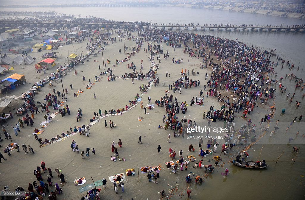 Indian Hindu devotees gather to take a holy dip at Sangam -- the confluence of the rivers Ganges, Yamuna and the mythical Saraswati -- to mark 'Mauni Amavasya' during the annual Magh Mela festival in Allahabad on February 8, 2016. AFP PHOTO/SANJAY KANOJIA / AFP / Sanjay Kanojia