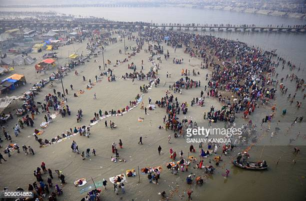 TOPSHOT Indian Hindu devotees gather to take a holy dip at Sangam the confluence of the rivers Ganges Yamuna and the mythical Saraswati to mark...