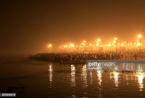 Indian hindu devotees gather to take a holy dip on the banks of holy sangam confluence of three rivers Gangayamuna and mythical saraswati on the...